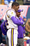 Randy Moss and Dennis Green. Wide Receiver Randy Moss and coach Dennis Green of the Minnesota Vikings gets ready to play in the National Football League Royalty Free Stock Photos
