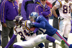 Randy Moss and Jason Sehorn. Vikings WR Randy Moss is tackled by Giants DB Jason Sehorn Royalty Free Stock Photo