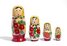 Rangée de quatre poupées de matryoshka Photo stock