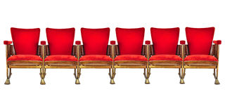 Rangée de six chaises de cinéma de vintage d'isolement sur le blanc image libre de droits