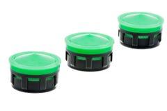 Rangée des aérateurs en plastique d'isolement de robinet Photos libres de droits