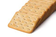 Rangée des biscuits sur le blanc Image stock