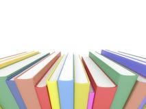 Rangée des livres sur le blanc Photographie stock libre de droits