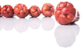 Rangée Rose Apple Fruit exotique IV Images libres de droits