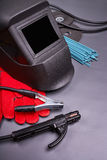 The range of accessories for welding. Welding equipment, welding mask, protective leather gloves, welding electrodes, high-voltage wires with clamps, cutting Royalty Free Stock Photo