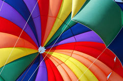 Range of Colors. Rainbow Parachute on the beach stock photo