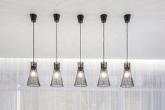 A range of fashionable lamps for bright interior loft stock images