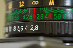 Range of focal lengths. On a vintage camera lens Stock Photos