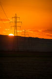 Sunset over power line Stock Image