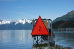 A range marker for a shipping channel in alaska. Royalty Free Stock Photo