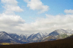 Range of mountains. Great view of range of mountains remaining snow on top Stock Images