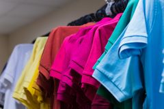 Range of multi-colored cotton t-shirts. In the clothing store Stock Photography