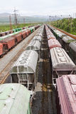 Range of multicoloured rail road waggons Stock Images