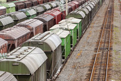 Range of multicoloured rail road waggons Royalty Free Stock Photo