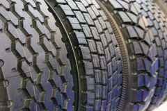 Range of new truck tyres in the service window Royalty Free Stock Photo