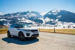 Range Rover bestselling model in the wild. Latest brand new white 2018 Range Rover Evoque. Beautiful car SUV in the nature deep in Alps stock photo