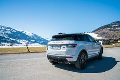 Range Rover bestselling model in the wild. Latest brand new white 2018 Range Rover Evoque. Beautiful car SUV in the nature deep in Alps stock images