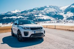Range Rover bestselling model in the wild. Latest brand new white 2018 Range Rover Evoque. Beautiful car SUV in the nature deep in Alps royalty free stock photography