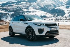 Range Rover bestselling model in the wild. Latest brand new white 2018 Range Rover Evoque. Beautiful car SUV in the nature deep in Alps stock image