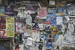 Rundown concertposters on a wall in Seattle stock photography