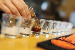 Range shots. A long line of alcoholic shots Royalty Free Stock Photo