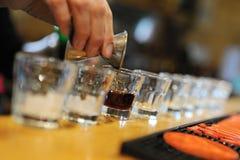 Range shots. A long line of alcoholic shots Stock Image