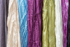 Range of silk scarves hanging together Stock Images