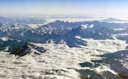 Himalaya mountains under clouds. View from airplane - Tibet Royalty Free Stock Images