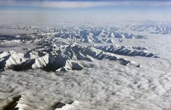 Himalaya mountains under clouds. View from airplane - Tibet Royalty Free Stock Image