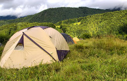 Range of tents in the mountains Royalty Free Stock Photography