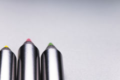 Range of three black wooden colour pencils on white background. With copy space stock photo