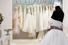 The range of wedding dresses. On hangers and on a mannequin in the showroom Royalty Free Stock Photo