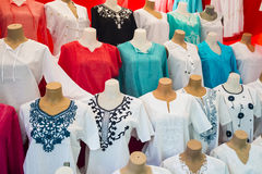 The range of women`s shirts on mannequins. Women`s tunics of different colors. What to wear to work. Stock Photography
