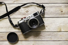 Rangefinder style camera on wooden table Stock Photos