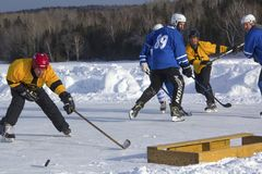 Men`s teams compete in a Pond Hockey Festival in Rangeley. Royalty Free Stock Photo