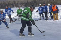Men`s teams compete in a Pond Hockey Festival in Rangeley. Royalty Free Stock Images