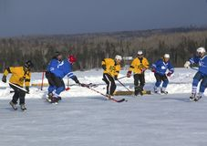 Men`s teams compete in a Pond Hockey Festival in Rangeley. Rangeley, Maine, USA - February 4, 2017: Men`s teams compete on the ice at the 11th annual New Stock Photos