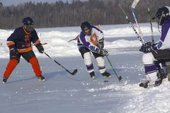 Women`s teams compete in a Pond Hockey Festival in Rangeley. Stock Images