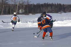 Women`s teams compete in a Pond Hockey Festival in Rangeley. Stock Image