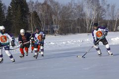 Women`s teams compete in a Pond Hockey Festival in Rangeley. Rangeley, Maine, USA - February 4, 2017: Women`s teams compete on the ice at the 11th annual New Stock Photos
