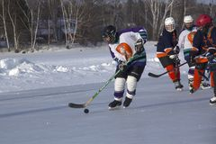 Women`s teams compete in a Pond Hockey Festival in Rangeley. Rangeley, Maine, USA - February 4, 2017: Women`s teams compete on the ice at the 11th annual New Royalty Free Stock Photography