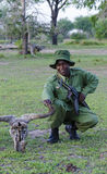 Ranger Selous Tanzania. Park ranger armed with assault rifle. Selous Game Reserve, Tanzania, Africa. The Selous was designated a UNESCO World Heritage Site in Royalty Free Stock Photos