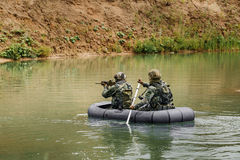 Rangers during the military operation in water Royalty Free Stock Photos