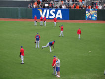Rangers players warm-up in the outfield during batting practice Stock Photo
