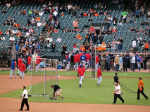 Rangers run into dugout after batting practice Royalty Free Stock Photo