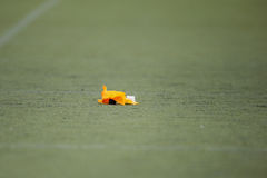 Rangers vs. Devils. MOEDLING, AUSTRIA - MAY 24, 2015: A penalty marker lies on the field in a game of the Division I of the Austrian Football League Royalty Free Stock Images