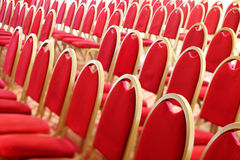 Ranges of empty red chairs. Stock Images
