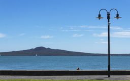 Rangitoto Island View from Mission Bay Beach Auckland New Zealand. In Sunny Day Royalty Free Stock Photography