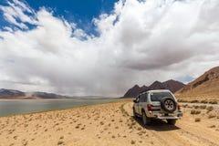 Nice Off-road vehicle at  Rangkul. RANGKUL, TAJIKISTAN - CIRCA JUNE 2017: Off-road vehicle at  Rangkul Lake in Tajikistan circa June 2017 in Rangkul Stock Photos