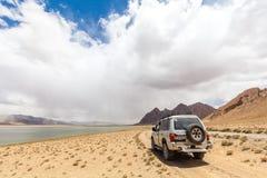 Nice Off-road vehicle at  Rangkul. RANGKUL, TAJIKISTAN - CIRCA JUNE 2017: Off-road vehicle at  Rangkul Lake in Tajikistan circa June 2017 in Rangkul Royalty Free Stock Image